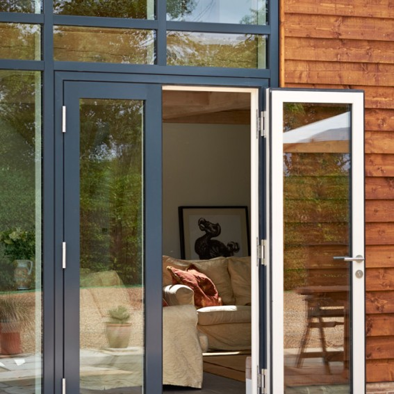 Timber french doors inward and outward opening livingwood for Outward opening french doors